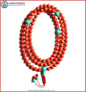 Carved Coral Mala with Turquoise Guru Bead