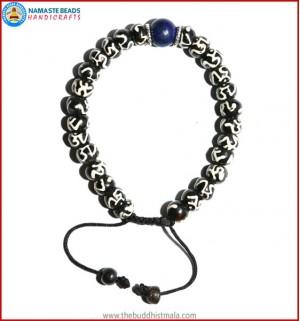 Tibetan OM Itching Bone Bracelet with Lapis Lazuli Bead