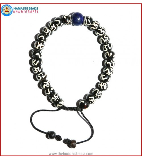 Tibetan OM Itching Bone Bracelet with Lapis Lazuli Bead
