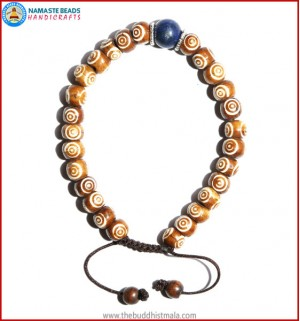 Brown Bone Carved Bracelet with Lapis Lazuli Bead