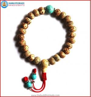 Flat Lotus Seed Wrist Mala with Turquoise Bead