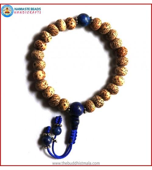 Flat Lotus Seed Wrist Mala with Lapis Lazuli Bead
