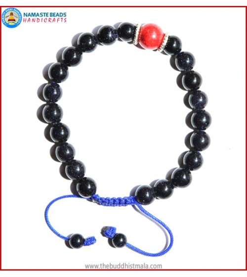 Blue Sun Stone Bracelet with Coral Bead