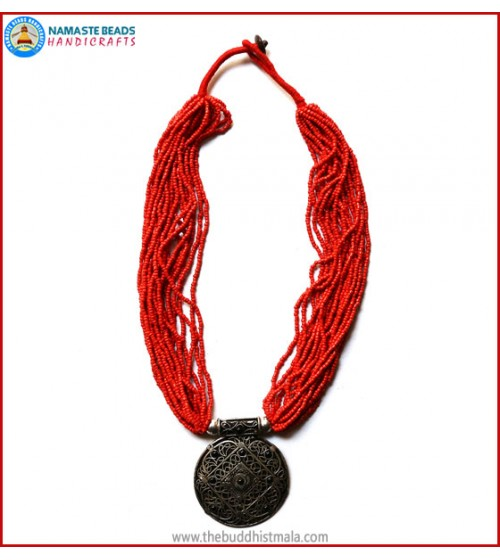 White Metal Pendant & Coral Necklace